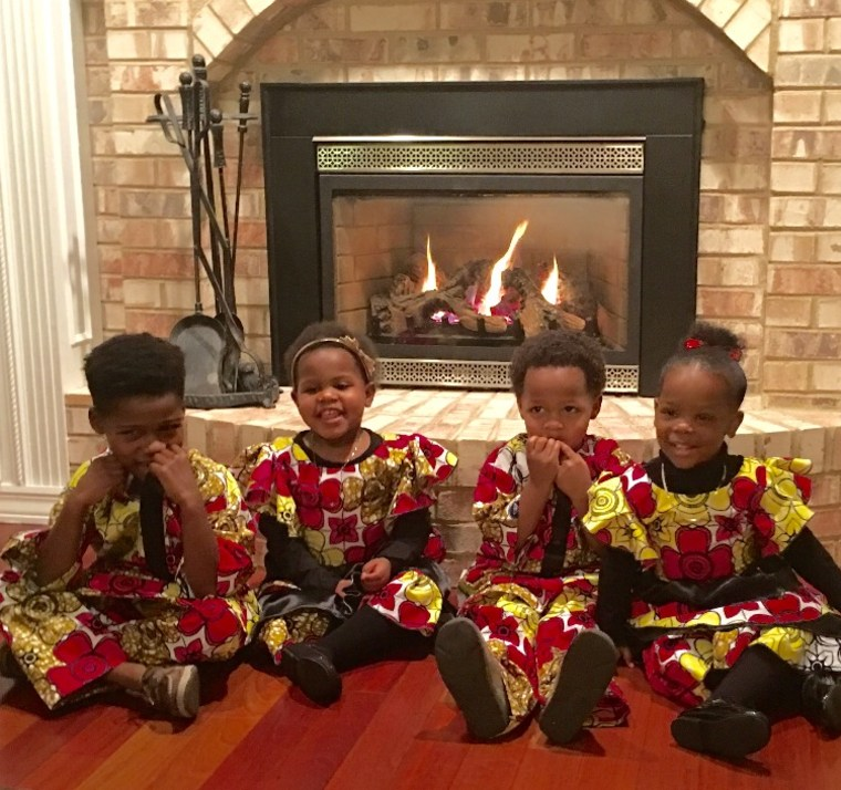 Sheinelle Jones's 8-year-old son and 5-year-old twins, pictured here with their cousin, wear traditional African native clothing for their family Christmas celebrations.