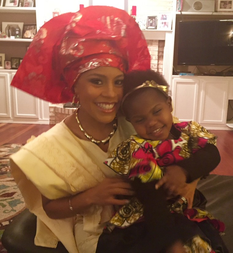 """TODAY's weekend co-anchor Sheinelle Jones (pictured here in traditional African native clothing with her daughter) said when she saw """"Black Panther,"""" """"I loved it so much, I couldn't wait to take my 8-year-old son. I wanted him to see a superhero who not only looked just like him, but was in touch with his humanity, honored his elders, made good decisions and treated the women in his life with so much respect and admiration. I knew he would love it."""""""