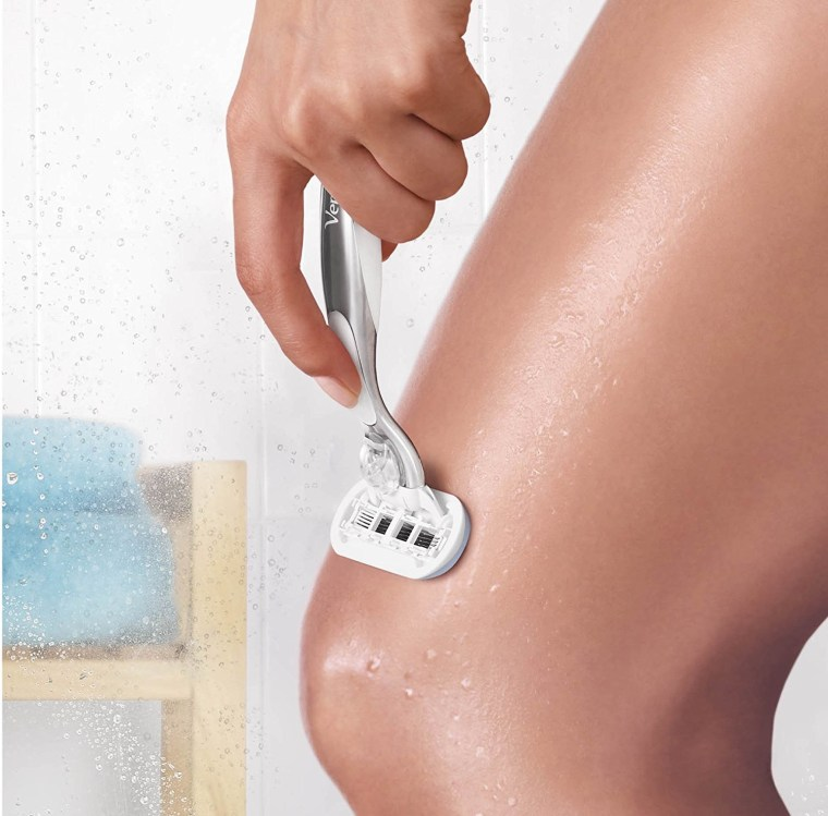 Woman shaving with Gillette Venus Platinum Extra Smooth razor