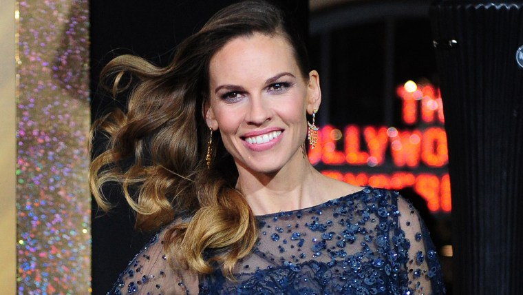 Actress Hillary Swank poses on arrival for the film premiere of 'New Year's Eve' at Grauman's Chinese Theater in Hollywood on December 5, 2011. The movie opens in theaters on December 9.