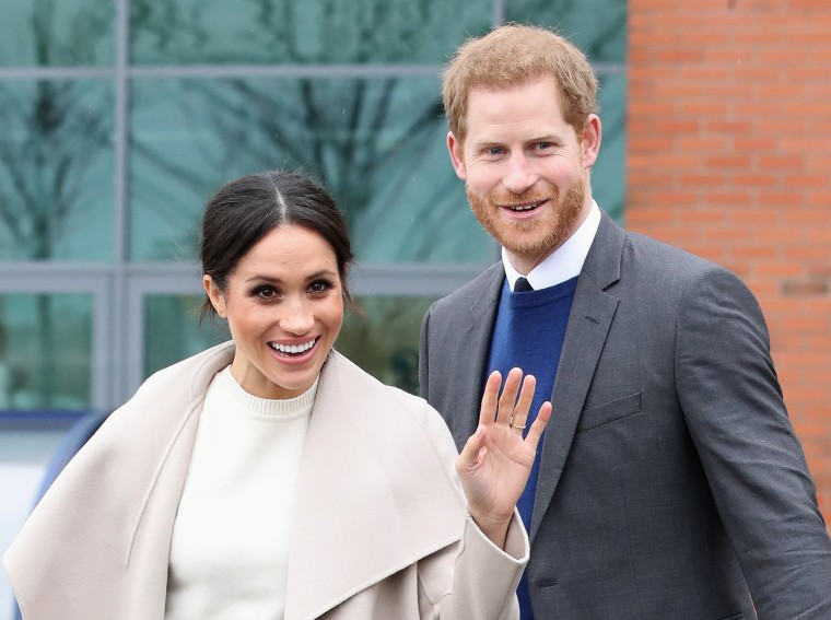 The fiancee of Britain's Prince Harry, Meghan Markle, reacts after a visit to a science park called Catalyst Inc., in Belfast