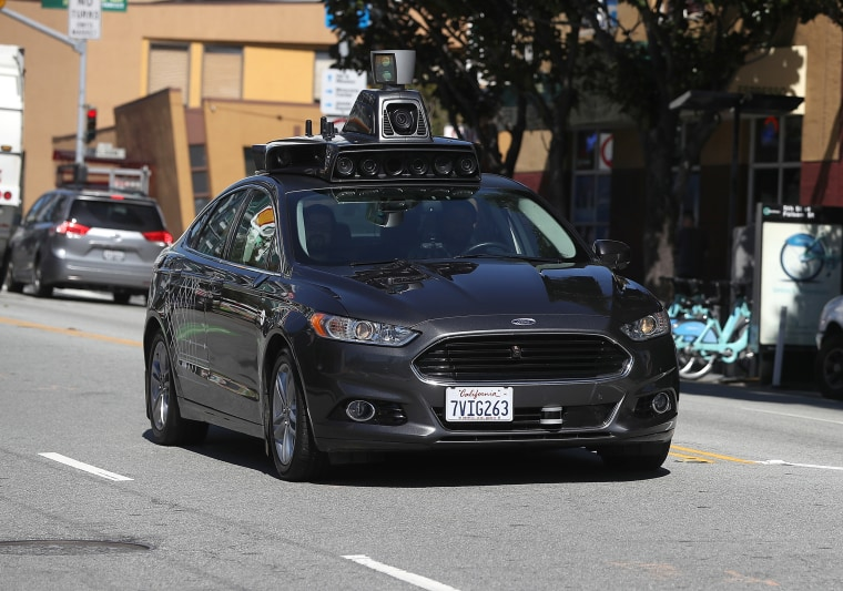 Image: An Uber self-driving car drives down 5th Street in San Francisco