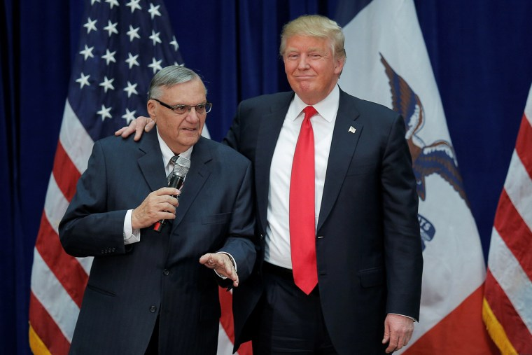 Image: Republican presidential candidate Donald Trump is joined onstage by Maricopa County Sheriff Joe Arpaio at a campaign rally in Marshalltown
