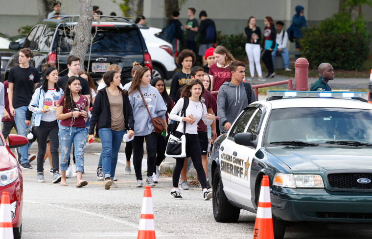 Image: Marjory Stoneman Douglas High School students and teachers return to school