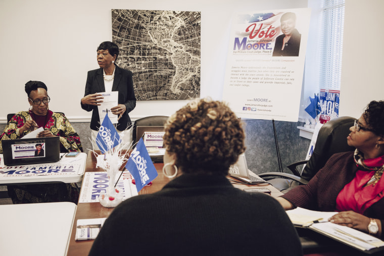 Image: Jameria Moore, an attorney and candidate for Jefferson County probate judge, works at her campaign headquarters in a back room at her law office with volunteers on March 13, 2018.