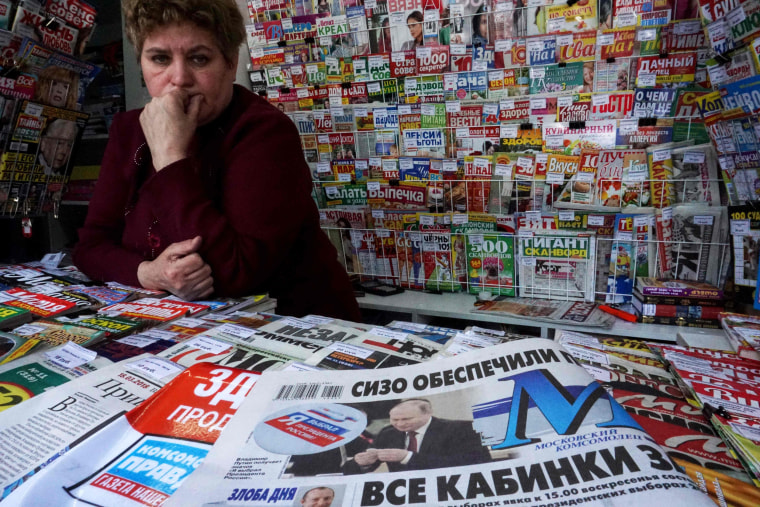 Image: A newspaper shows Russian President Vladimir Putin