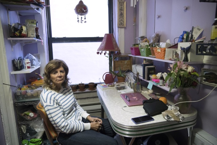 Image: Mary Ann Siwek sits in her apartment in the East Village