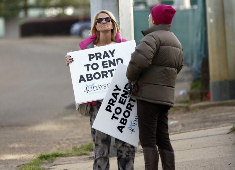 Image: Kami Bullock, left, and Barbara Beavers, both anti-abortion supporters