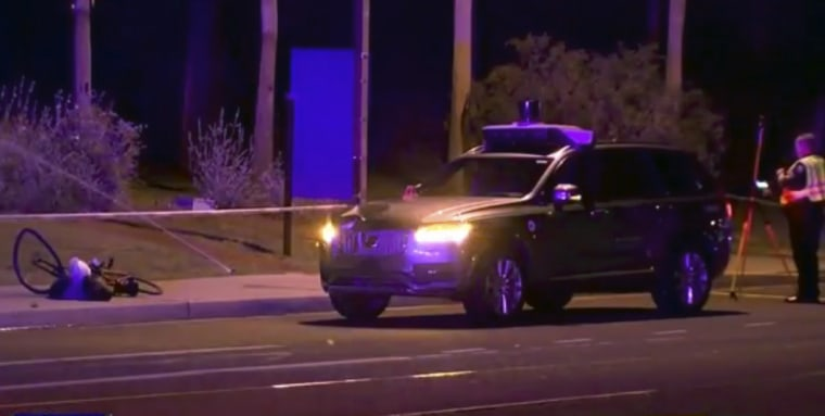 Image: Investigators at the scene of a fatal accident involving a self-driving Uber car on the street in Tempe, Arizona.