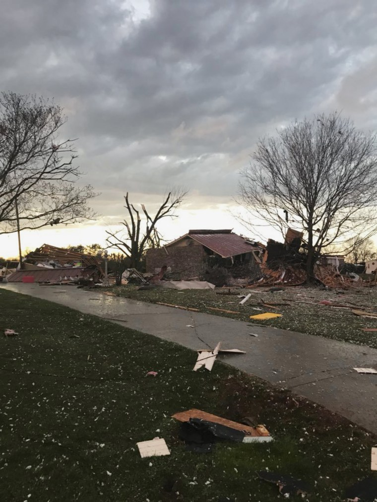 Scattered debris covers the ground in Ardmore, Alabama, on March 19. Severe storms that spawned tornadoes damaged homes and downed trees as they moved across the Southeast on Monday night.