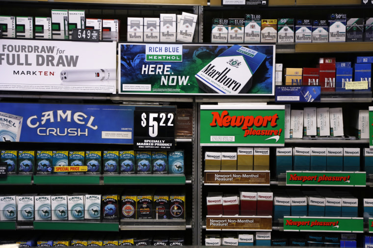 Camel and Newport cigarettes, both Reynolds American brands, are on display at a Smoker Friendly shop in Pittsburgh in 2015.