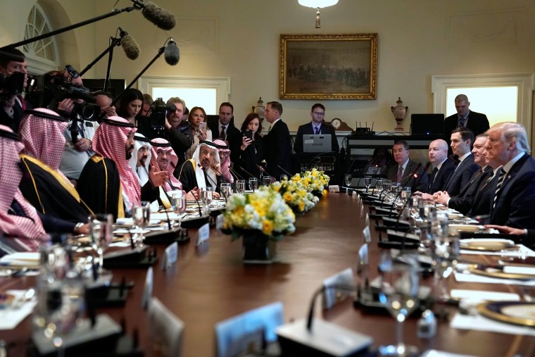 Image: President Donald Trump and Saudi Arabia's Crown Prince Mohammed bin Salman sit down to a working lunch