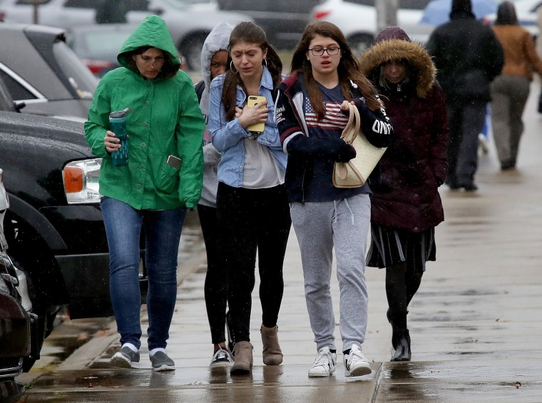 Image: Students from Great Mills High School walk to meet their parents