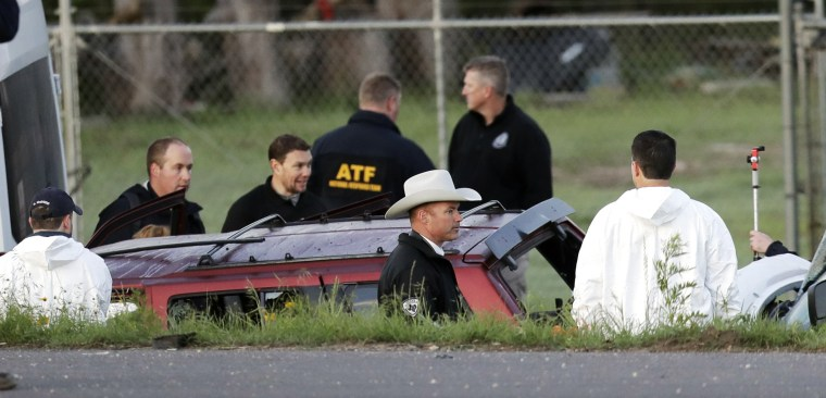 Image: Officials investigate the scene in Round Rock, Texas