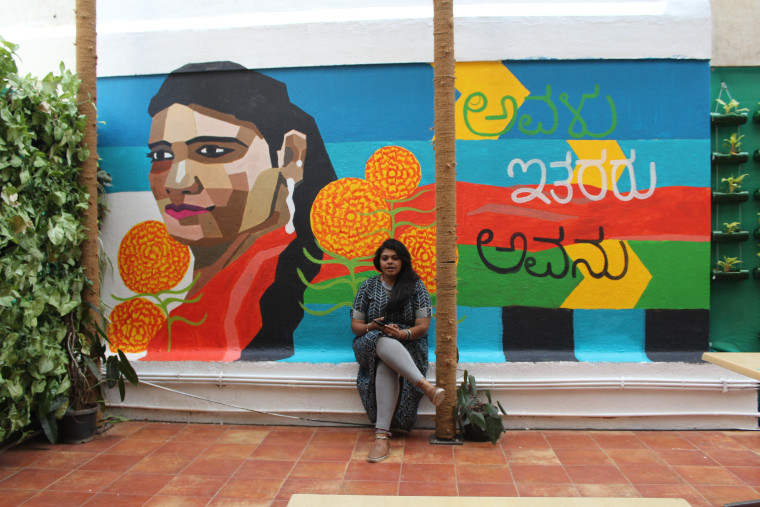 Poornima Sukumar with a finished mural in Bangalore, India, in March 2018.