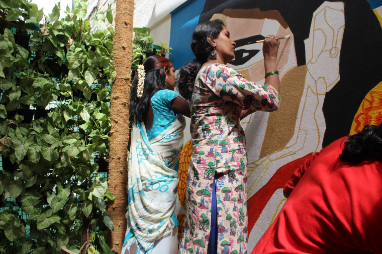 Meghala and Priyanka painting a mural in Bangalore, India, in March 2018.