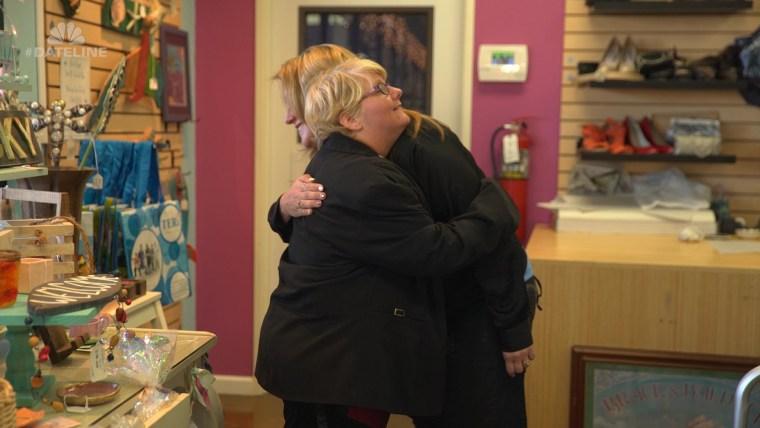Shaunda Anaya, store manager of TERI Inspired Resale, hugs Heather, a store employee.