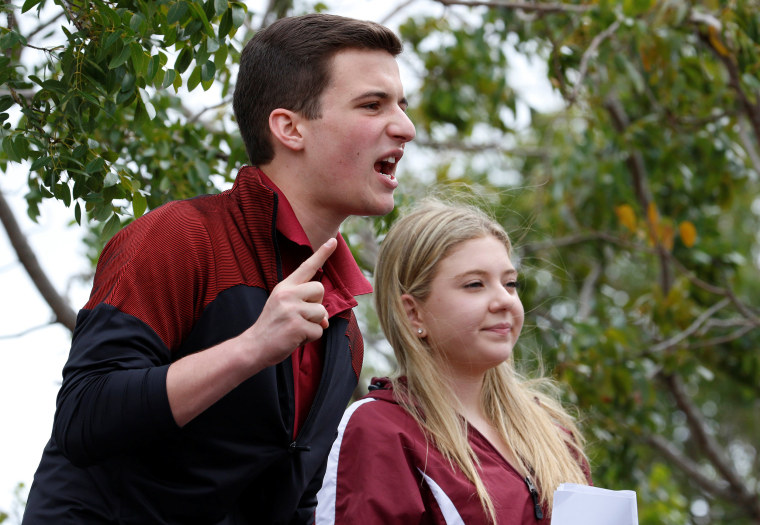 Image: Marjory Stoneman Douglas High School student leaders Kasky and Corin speak to the crowd prior to boarding buses to Tallahassee, in Coral Springs
