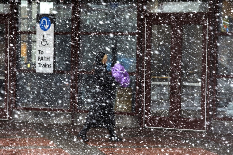 Image: People enters the PATH station during a snow storm