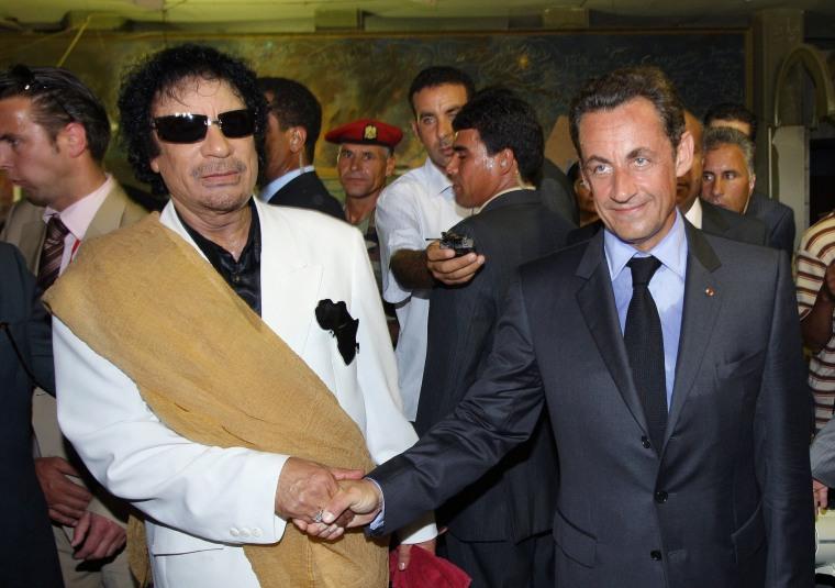 Image: Nicolas Sarkozy and Muammar Gadhafi