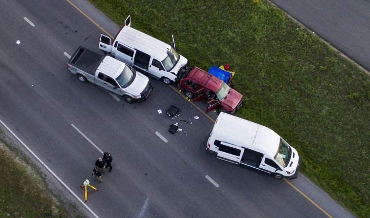Image: Officials investigate near a vehicle where the suspect in the bombings that terrorized Austin blew himself up