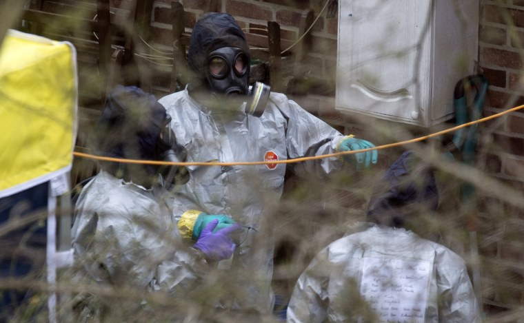 Image: A team believed to be from the Organisation for the Prohibition of Chemical Weapons (OPCW) inspects the back garden of house