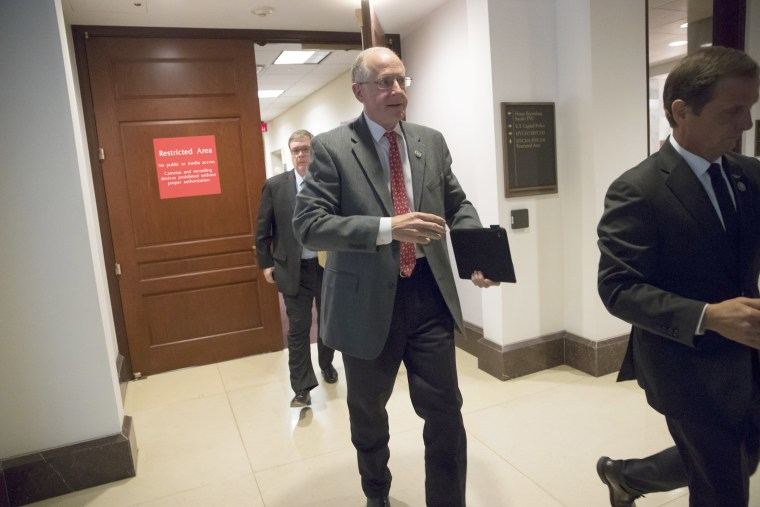 Image: House Intelligence Committee members Rep. Mike Conaway, R-Texas, with Rep. Chris Stewart, R-Utah, right, leave the secure area where the panel was wrapping up its inquiry into Russian meddling in the 2016 election, March 22, 2018.