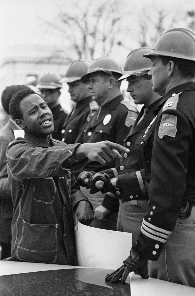 Image: Willie Ricks pleads with Alabama State Troopers to permit him and other voters rights demonstrators to picket on the sidewalk of the state capitol