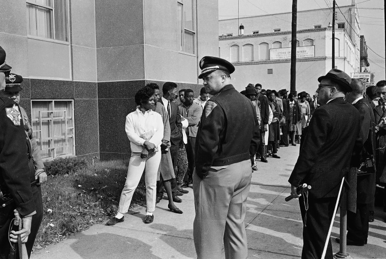 Image: Sheriff Jim Clark, Dallas County Selma, Alabama, stands in front of a group of African-Americans