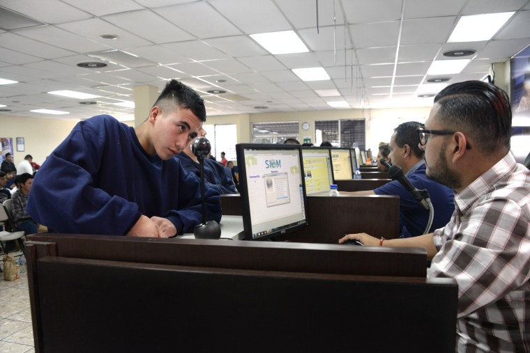 Image: An immigrant deported from the U.S. is registered by migration authorities in Guatemala City