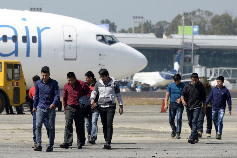 Image: A group of deported immigrants arrive at the Air Force base in Guatemala City