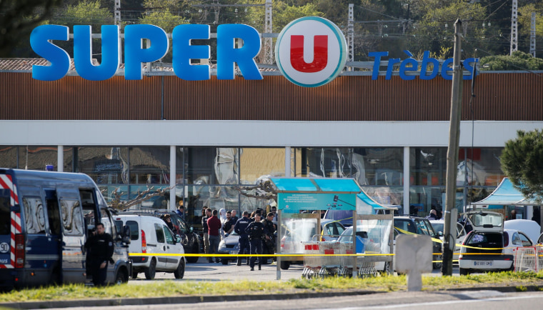Image: A general view shows gendarmes and police officers at a supermarket after a hostage situation in Trebes