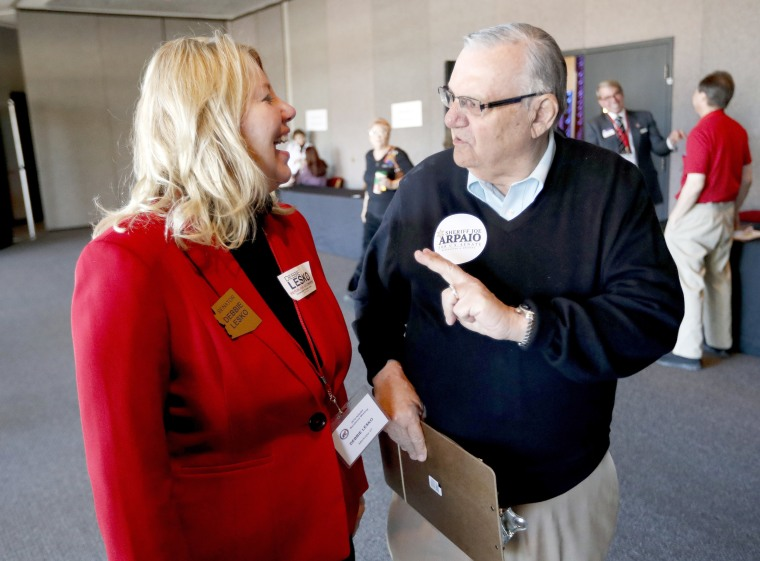 Image: Arizona State Rep. Debbie Lesko speaks with former Maricopa County Sheriff and U.S. Senatorial candidate Joe Arpaio during the meeting of the state committee of the Arizona Republican Party, Jan. 27, 2018 in Phoenix.