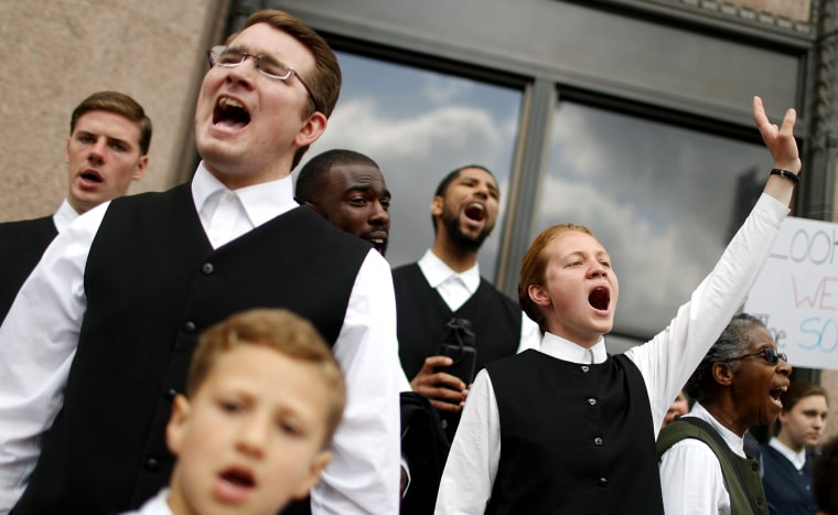LOS ANGELES, CA - MARCH 24:  A church group sings on the street during the march in Los Angeles, California.