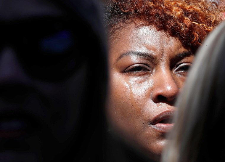 A demonstrator in the crowd becomes emotional while watching the stage at the rally in Washington, DC.