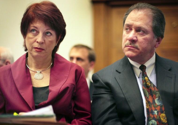 Image: Victoria Toensing and Joe diGenova listen to former CIA agent Valerie Plame Wilson testify