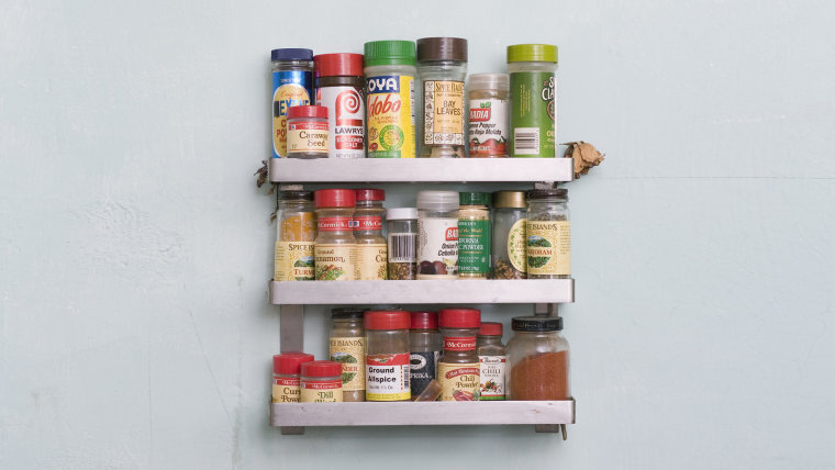 Vintage 'diner' sign on a wall above a spice rack