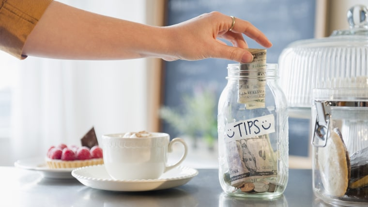 Image: Traditional tip jars have disappeared, in favor of tips made on credit cards.