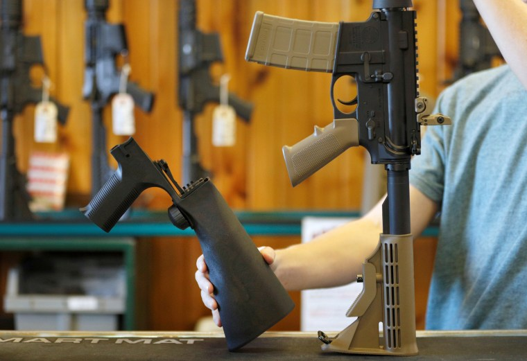 Image:  A bump fire stock, left, that attaches to a semi-automatic rifle...
