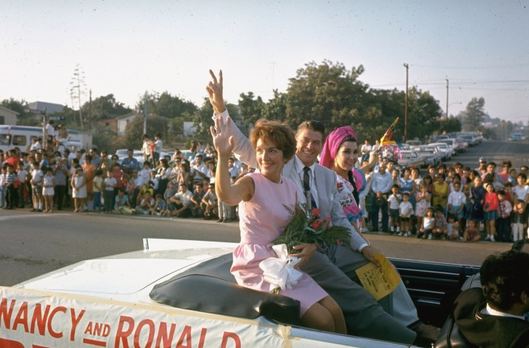 Image: California Republican gubernatorial candidate Ronald Reagan and his wife Nancy wave to spectators