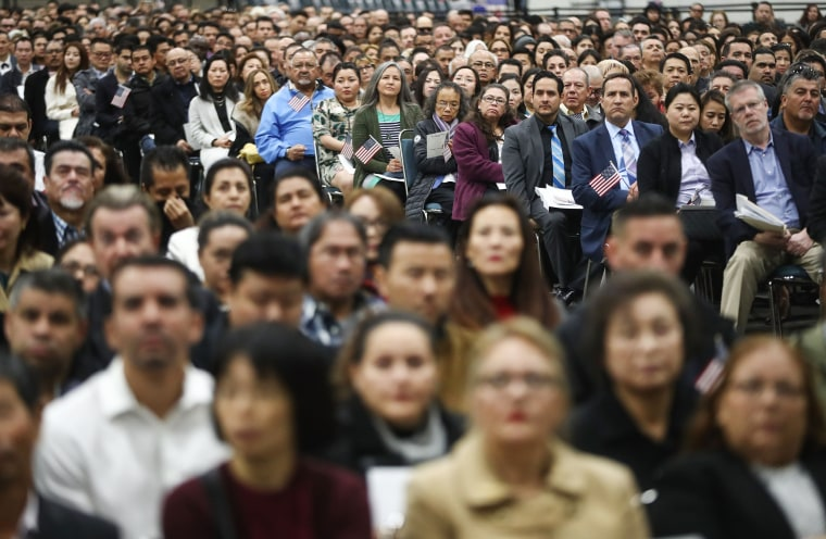 Image: New American citizens gather at a naturalization ceremony