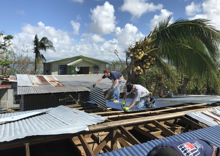 Image: Volunteers rebuild rooftops in La Playita, Puerto Rico