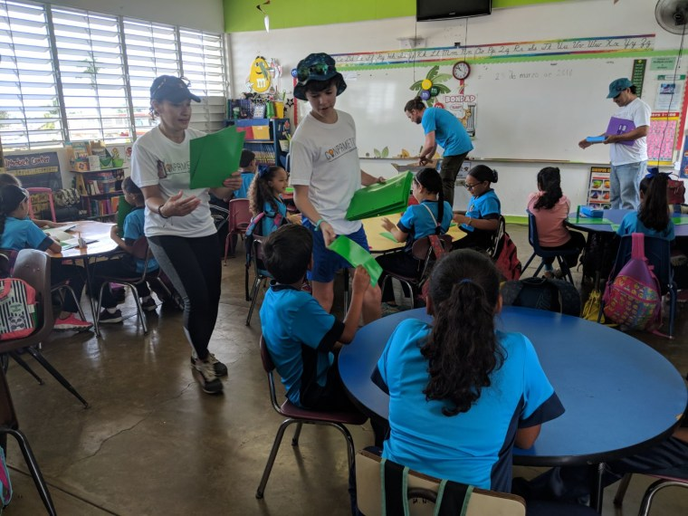 Former White House officials visit an elementary school in Comunidad Isaac Del Rosar in Puerto Rico.