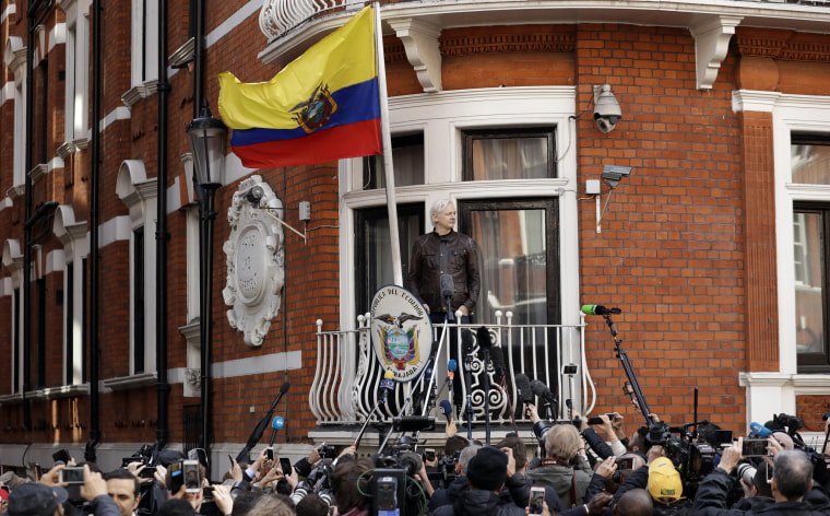 Image: WikiLeaks founder Julian Assange stands on the balcony of the Ecuadorian embassy prior to speaking