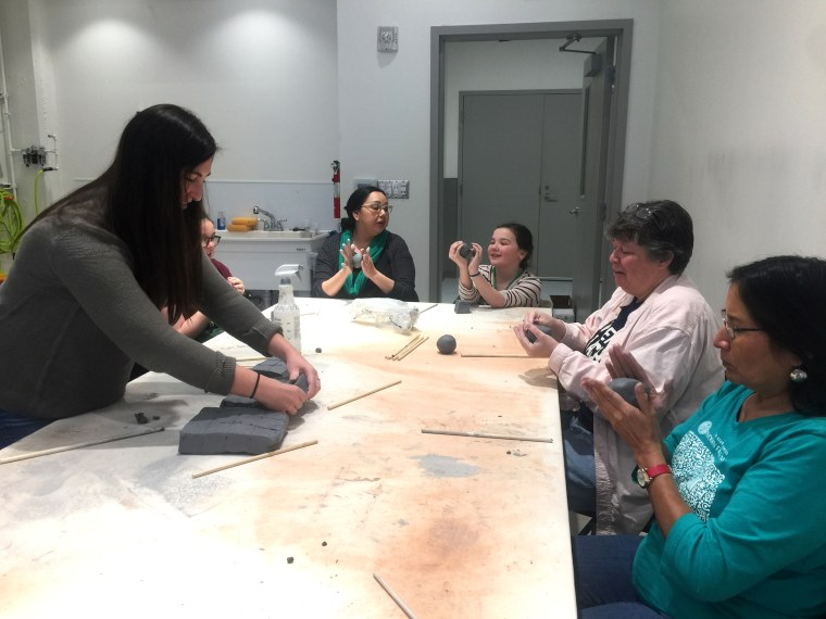 Image: Participants make beads for a large-scale art project at a gathering in Tulsa, Oklahoma.