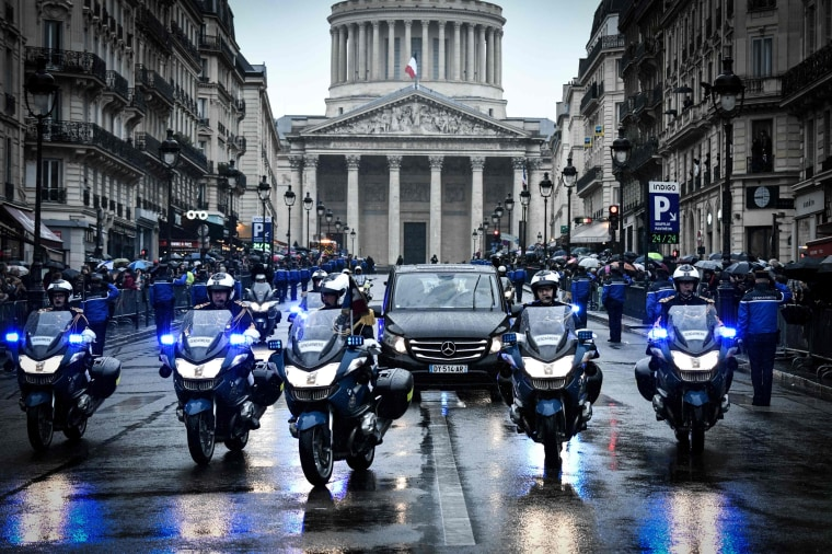 Image: French gendarmes escort the coffin