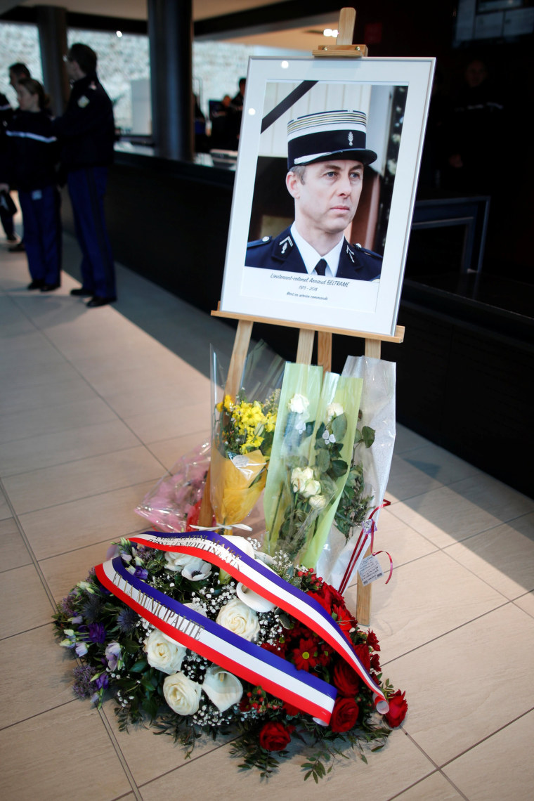Image: A portrait of late officer Colonel Arnaud Beltrame is seen at the Gendarmerie Nationale Headquarters in Issy-les-Moulineaux