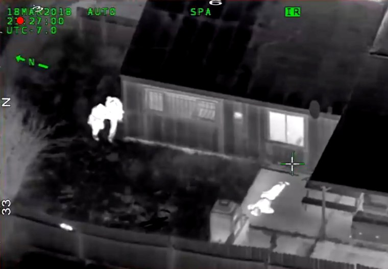 Image: Stephon Clark is visible on the ground after two police officers shot him, in this still image captured from police aerial video by Sacramento Police Department