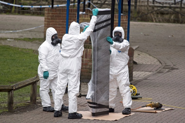 Image: Army Officers remove bench at the centre of Skripal poisioning case