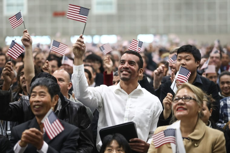 Image: Thousands Of Immigrants Are Naturalized In Citizenship Ceremony At  L.A. Convention Center